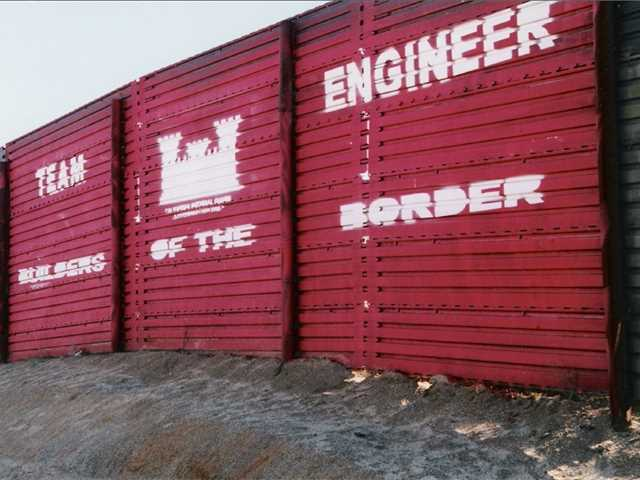 Border fencing from the era of the 1990s Operation Gatekeeper, near Campo, California, …